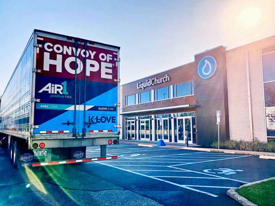 Convoy of Hope big rig outside a church