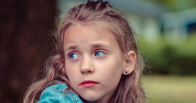 Young girl looks sad