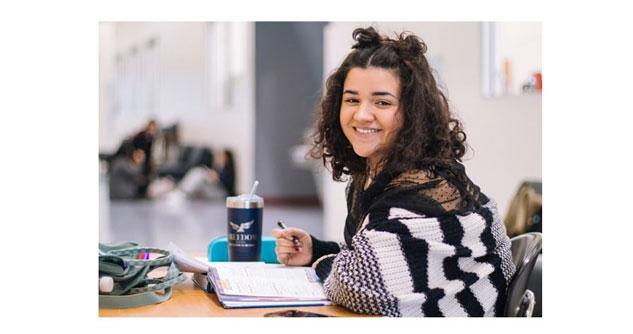 Young girl at school smiling at camera